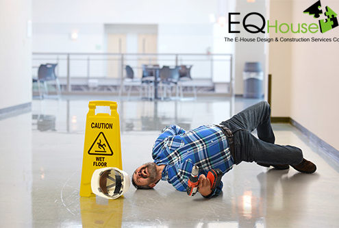 worker falling on wet floor crying in pain